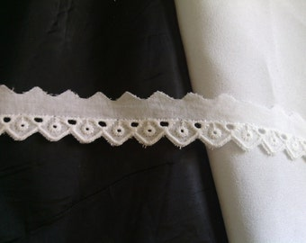 1 yard off white cotton scalloped embroidered eyelet trim 1 7/8 inch wide.