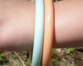 Two 1970s Aqua and Peach Lucite Bangle Bracelets