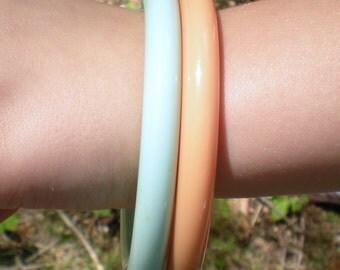 Two 1970s Aqua and Peach Lucite Bangle Bracelets