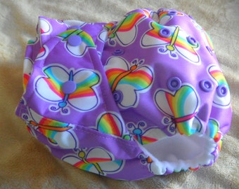 SassyCloth one size pocket diaper with rainbow butterflies on lavender PUL print. Made to order.