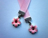 Cute flower charms on a ribbon bookmark.
