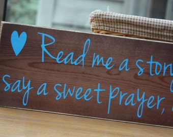 Wooden sign with vinyl lettering - Read me a story, tuck me in tight, say a sweet prayer, and kiss me goodnight.