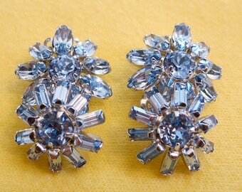 Beauiful  SHERMAN clip on ice blue, Austrian crystal earrings.Overlapping flower design. The 2 flowers are different.  TOVAN13.6-8.1.