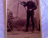 vintage 1910 dapper teetotaler  with a penny farthing bicycle photograph/personal ad?