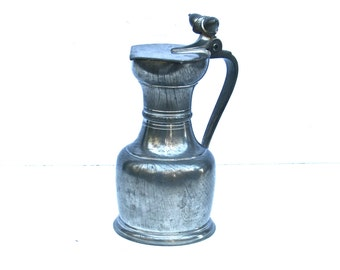 Pewter Flagon with a Acorn Thumb Piece