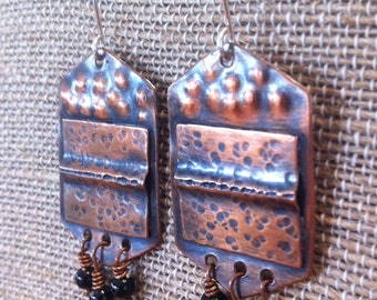 Handmade fold formed copper and sterling silver black glass bead earrings