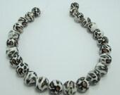 De-stash Acrylic Animal print beads 1 strand Item 014