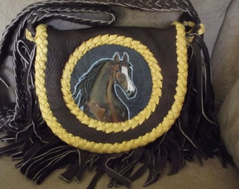 beautiful Arabian stallion on brown elk skin with gold deer skin lacing