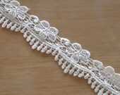 Venice Lace Scalloped Embroidery Trim 2 Inches Wide In Off White or Light Cream Color.
