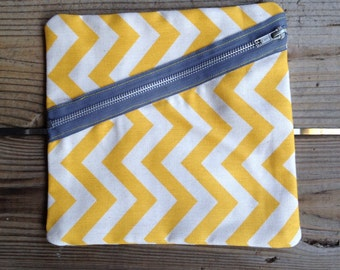 Chevron clutch with gray exposed zipper