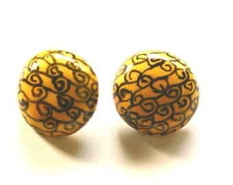 yellow and black clip earrings