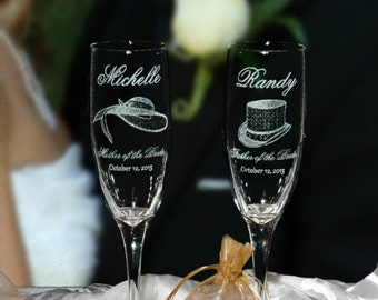 Beautiful Hats on Tall Champagne Glasses for the Parents of the Bride and Groom