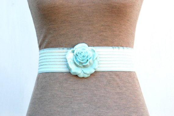 Ladies stretch belt with rose clasp in mint by Charmant Belts, 1980's.