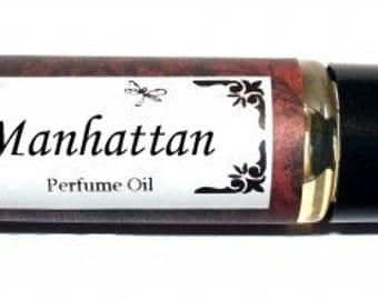 MANHATTAN -  Roll on Premium Perfume Oil - 2 sizes to choose from - 1/3 oz or 1/6 oz  - musk & sandalwood w/ Winter Flowers