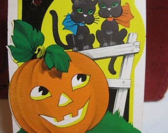 1930's-40's unused art deco die cut Halloween bridge tally card jack o' lantern looking up at 2 black cats on a fence and full moon
