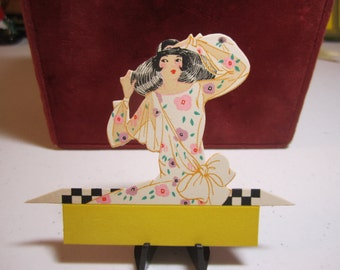 Pretty 1920's -30's art deco die cut Gibson place card bobbed haired lady in large hat and stylized deco flower dress with sheer sleeves