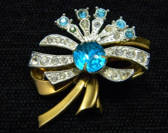 Vintage Bow brooch with turquoise rhinestones