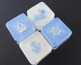 Nautical Baby Blue Shower Favors with ships wheel, anchor, sailboat, and whale