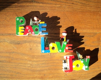 3 Vintage Holiday  Wooden Candle Holders with the words, PEACE, LOVE and JOY cut out of wood and hand painted in primary colors, Good shape