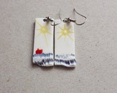 Long white ceramic handmade dange earrings with sun, sea and a little red boat