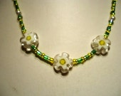 Necklace Green and Yellow rocaille seed bead with Glass Daisy Flower Beads by JulieDeeleyJewellery on Etsy