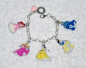 Adorable silver charm bracelet with colorful Disney enamel Princess charms.  Snow White, Ariel, Belle, Cinderella and Aurora Sleeping Beauty