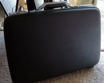 American tourists tiara dark gray briefcase with red leather interior