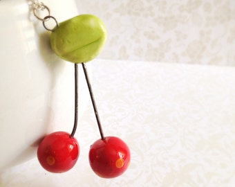 Ceramic Double Cherry Necklace. Glazed Ceramic. Green. Red. Fruit. Summer. Sweet. Whimsical. Silver Chain. Under 25. Miniature Cherry. Gifts