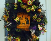 Halloween --The Witch Is In at the Annual Gathering Whimsical Halloween Wreath with Boney Hands, Legs with Boots and  Lightable Skull