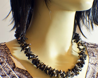 Dramatic black shell kumihimo necklace beaded kumihimo braid with silver plated ends and lobster clasp
