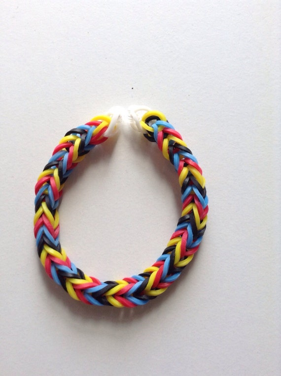 Red yellow black and blue fishtail rubber band by cutiepiebracelet