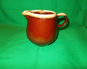 One (1), 8 oz Creamer from McCoy, in the Brown Drip Pattern