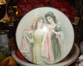 Early 1900's Victorian ladies in Winter gowns round print with metal frame and chain