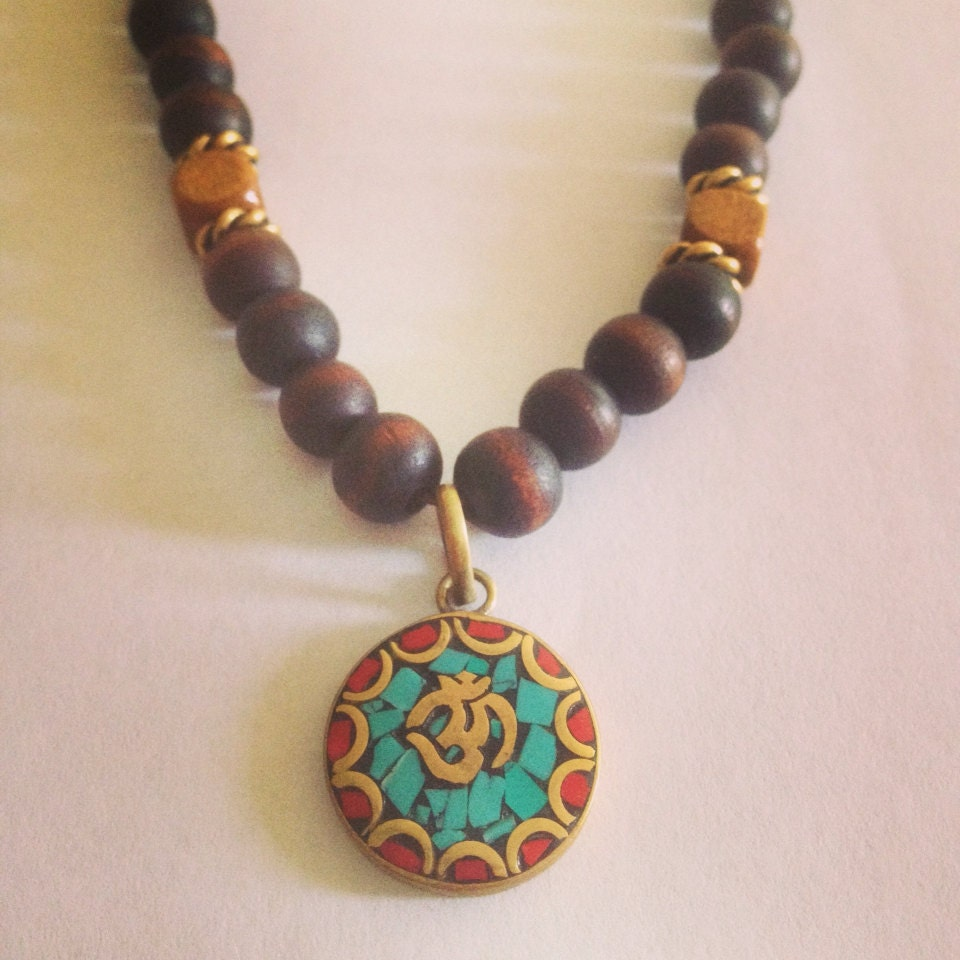 sale wooden ohm necklace by theartsynomad on etsy
