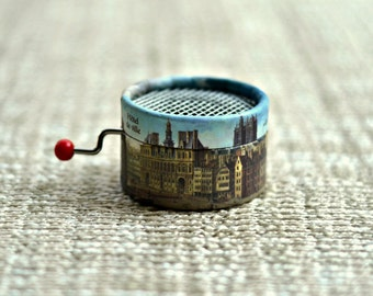 Hand cranked Music box decorated with Paris Buildings. Personalized with the your song you choose from the list. Blue.