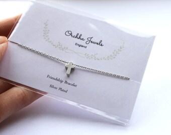 Tiny Silver cross charm friendship bracelet