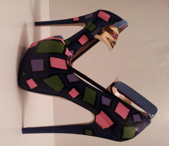 multi colored painted high heel shoes