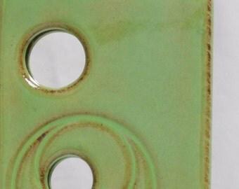 Peek-a-boo slim bright olive green ceramic wall mirror