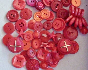 Lot of more than three dozen mixed size/style red plastic buttons