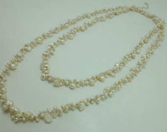 white freshwater pearl hand knotted on silk thread necklace.