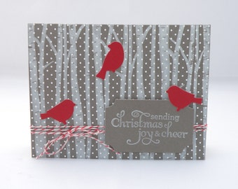 Red Birds in Snowy Woods Christmas card in Red and Gray