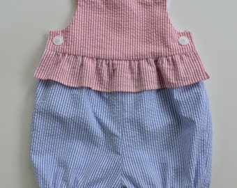 Infant girl's bubblesuit/romper in red, white and blue striped seersucker. Patriotic summer picnics.  Ruffle at waist.  Newborn to 18 mo.