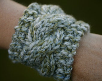 Cable wrist cuff (cable needle holder)  in chunky blue and green variegated yarn