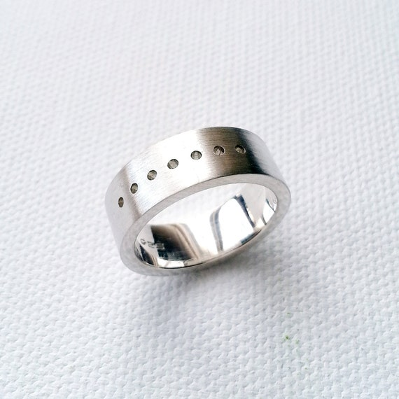 modern and clean looking sterling silver band unique and