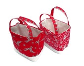 2 little fabric Xmas gift bags set with reindeer and snowflakes in red, white and silver