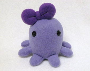 Stuffed octopus plush toy with bow