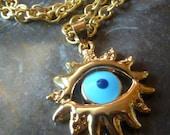 Mediterranean evil eye starburst pendant.