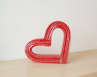 Red heart sculpture, bright red, ceramic heart outline sculpture that stands on the side, modern heart  art object