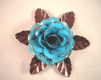 Large Metal Hand Cut and Hand Painted Rustic Blue Color Rose Mounted on a Bed of Metal Leaves.