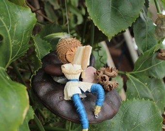 Man lying back and reading a book, Eco Gift for Men made from natural materials,